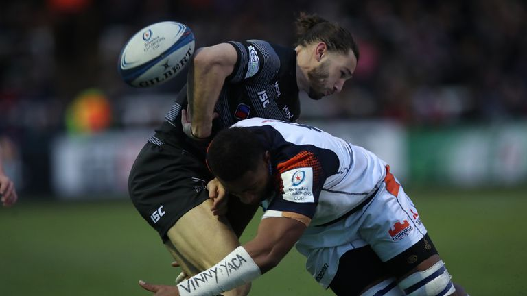 Tom Arscott  is tackled by Viliame Mata