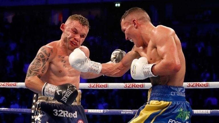 Josh Warrington beats Carl Frampton on points to retain world title