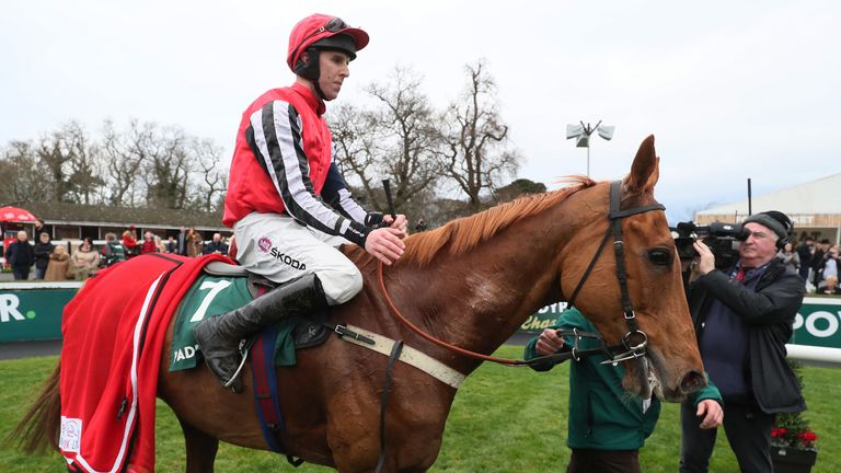 Simply Ned and jockey Mark Walsh (left) in the parade ring after winning the Paddy's Rewards Club 'Sugar Paddy' Steeplechase