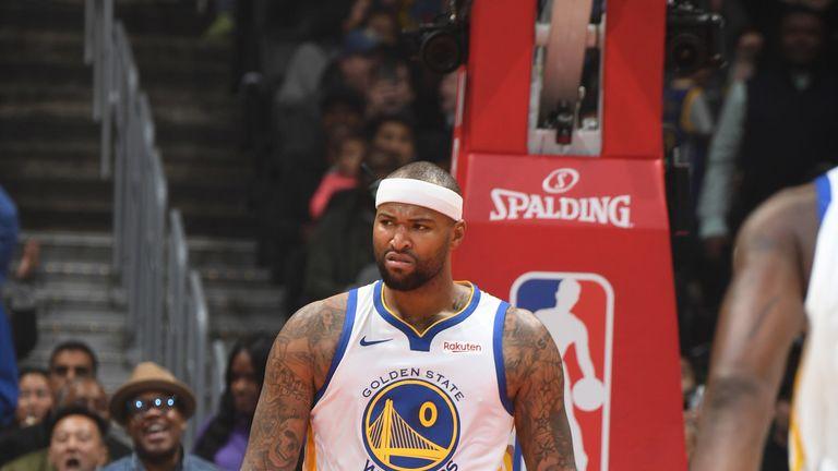 DeMarcus Cousins offers a trademark sneer following an emphatic dunk on debut for Golden State