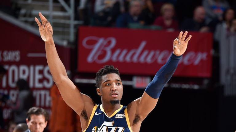 Donovan Mitchell salutes the crowd after draining a three-pointer