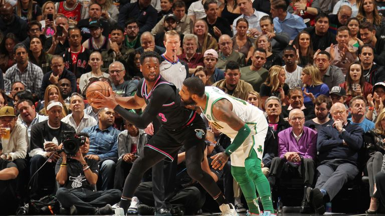 Dwyane Wade is guarded by Kyrie Irving