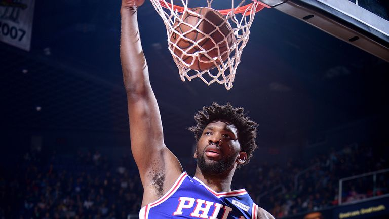 Joel Embiid scores with a dunk against Phoenix