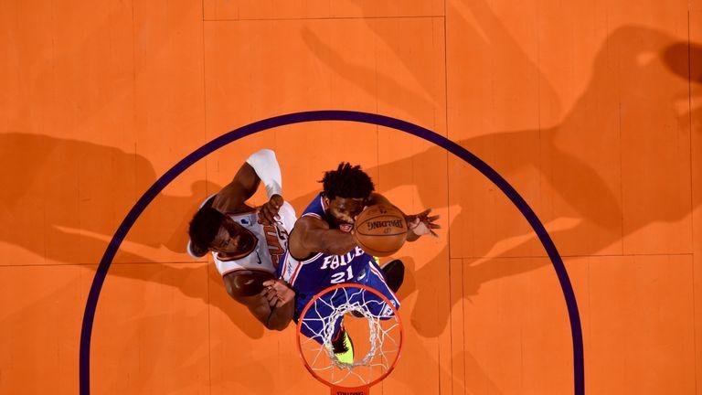 Joel Embiid dunks hard against the Phoenix Suns