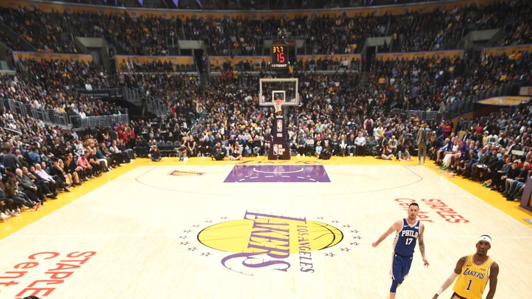 Joel Embiid battles to the rim against the Los Angeles Lakers
