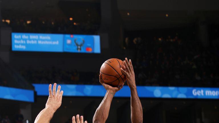 Kawhi Leonard launches a jump shot against Milwaukee