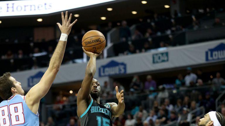 Kemba Walker lofts a floater against Sacramento