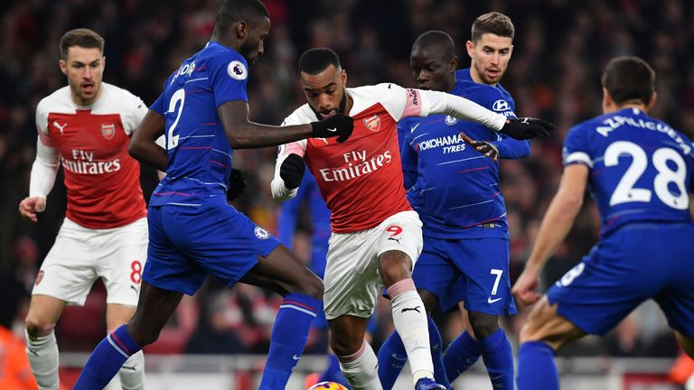 Lacazette battles through a crowd of blue shirts