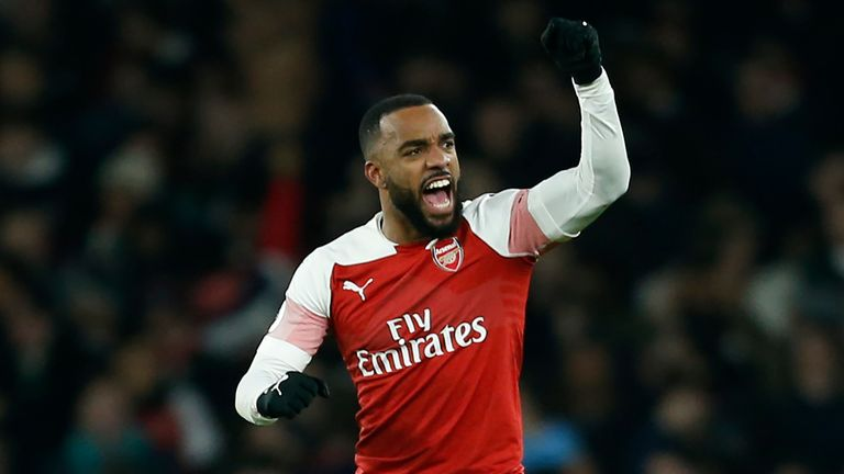 Alexandre Lacazette celebrates his opener against Chelsea