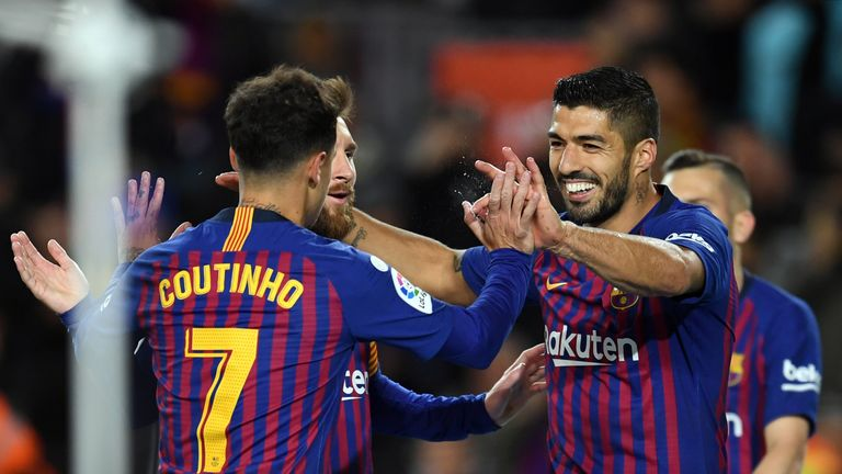 Coutinho is unassuming compared to Barca team-mates Suarez (right) and Messi
