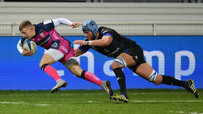 Ben Vellacott of Gloucester breaks past Christophe Samson