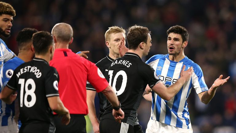 Christopher Schindler protests his innocence after being shown a red card by referee Mike Dean against Burnley