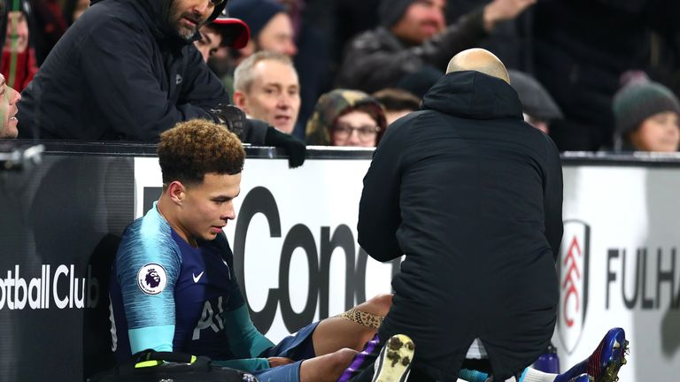 Dele Alli of Tottenham reacts to an injury during the Premier League match between Fulham FC and Tottenham Hotspur at Craven Cottage on January 20, 2019 in London, United Kingdom.