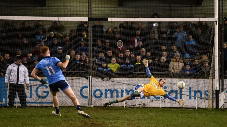 Tucked away: Aaron Byrne of Dublin scores a penalty against Barry Dardis of Meath during the penalty shootout