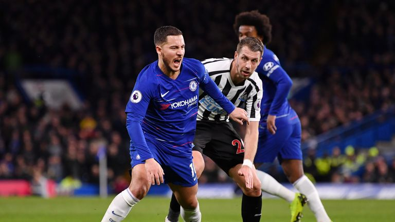 Eden Hazard is challenged by Florian Lejeune