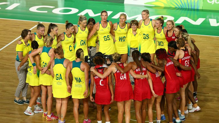 Australia and England huddle after the full-time whistle on the Gold Coast