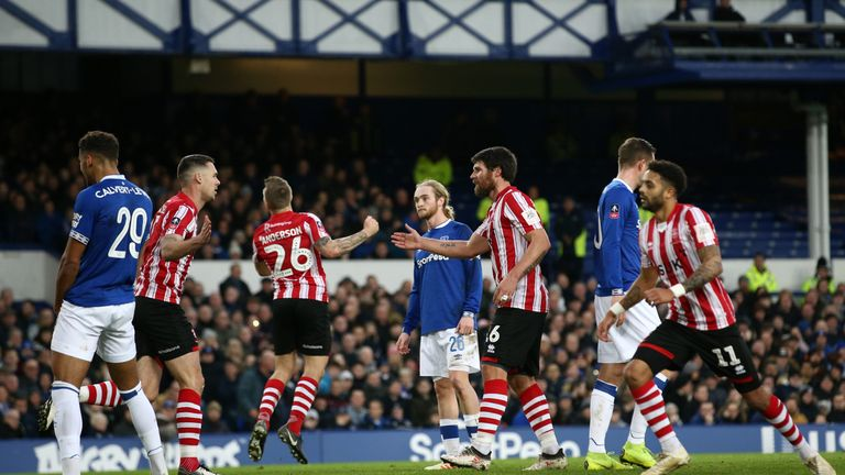 Michael Bostwick scores from a set piece to give Lincoln a lifeline at Goodison