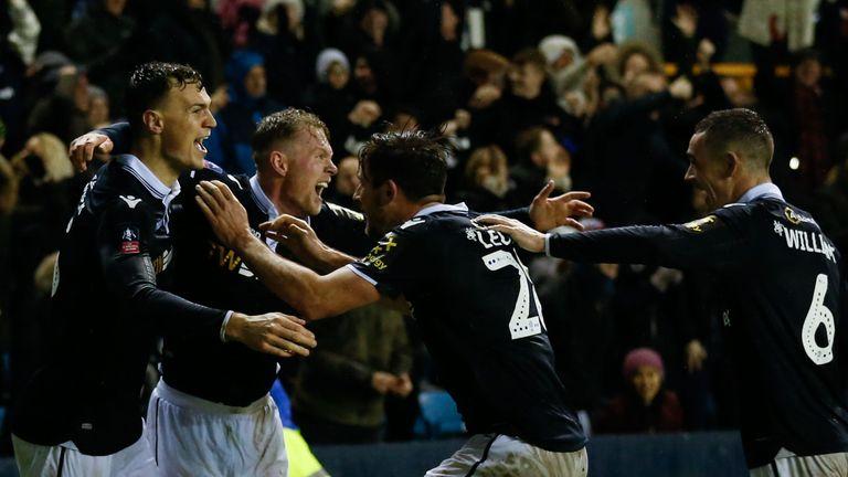 Millwall defender Jake Cooper (left) celebrates scoring their second goal against Everton