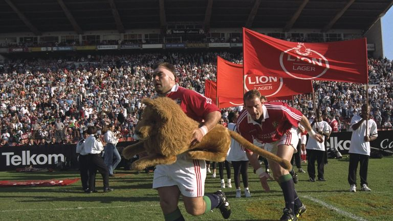 Leonard leads the British Lions on to the field of play for the first match of the 1997 tour of South Africa