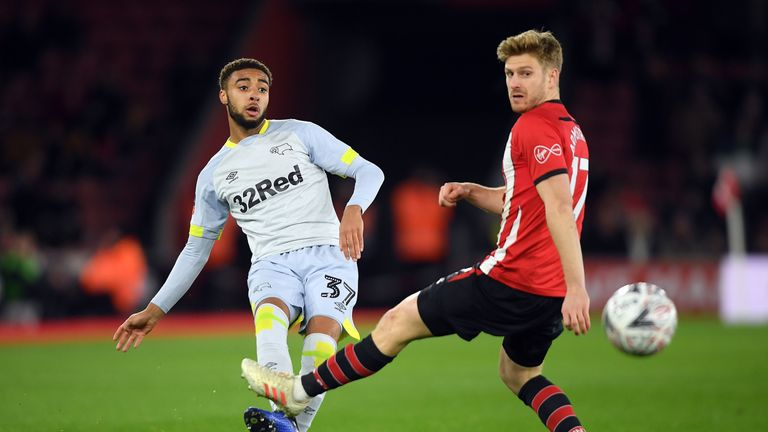 Jayden Bogle of Derby County is challenged by Stuart Armstrong of Southampton