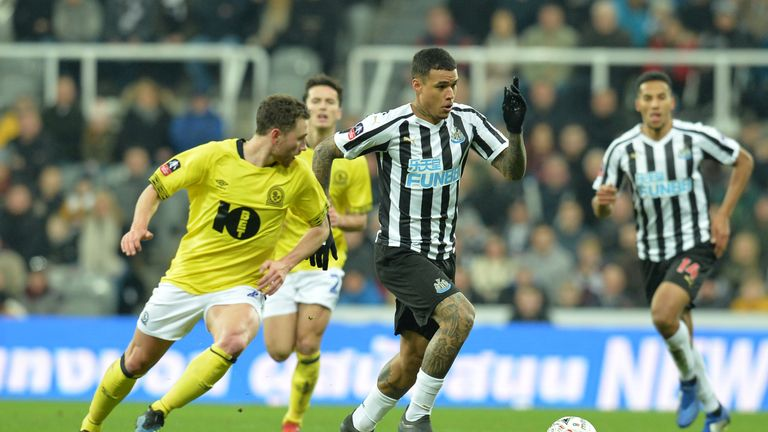 Kenedy tussles for the ball at St James' Park