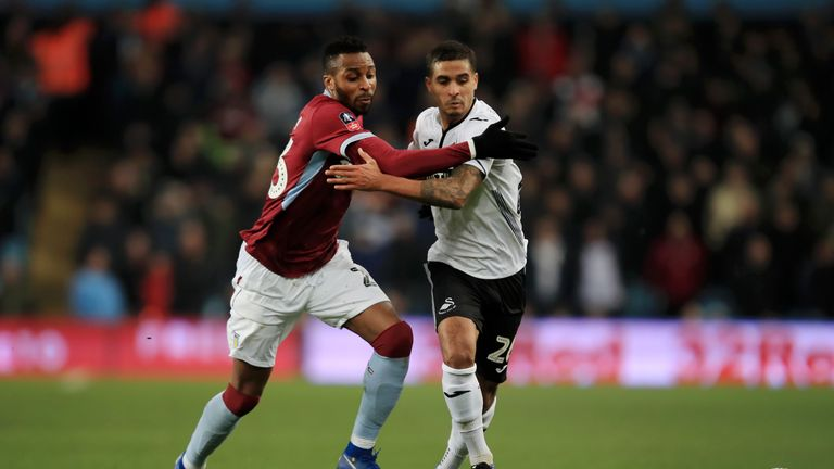 Kyle Naughton (R) battles for possession with Jonathan Kodjia