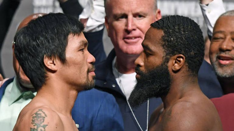 WBA welterweight champion Manny Pacquiao (L) and Adrien Broner face off during their official weigh-in at MGM Grand Garden Arena on January 18, 2019 in Las Vegas, Nevada. Pacquiao will defend his title against Broner on January 19 at MGM Grand Garden Arena in Las Vegas.  (Photo by Ethan Miller/Getty Images)