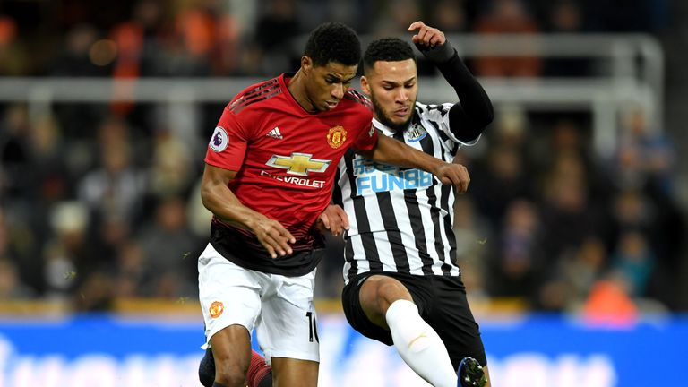 Marcus Rashford is challenged by Jamaal Lascelles