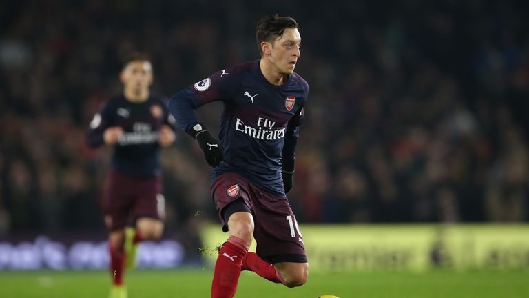 Mesut Ozil's agent says the German is 100 per cent committed to Arsenal