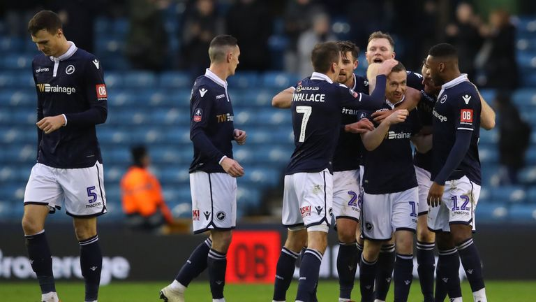 Millwall players celebrate their team's first goal
