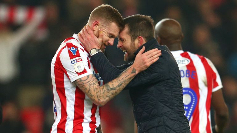 Stoke City manager Nathan Jones celebrates at full time with James McClean