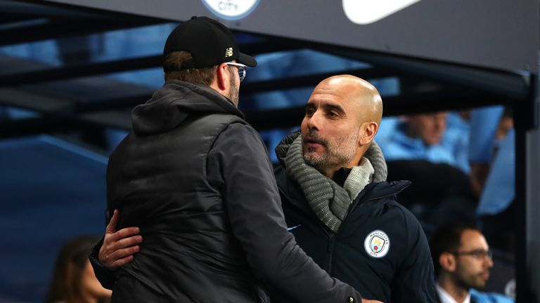 Pep Guardiola and Jurgen Klopp embrace before kick-off