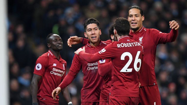 Roberto Firmino celebrates his equaliser for Liverpool