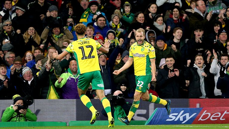 Norwich City's Teemu Pukki (right) celebrates scoring his side's first goal of the game