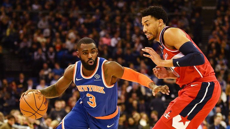 New York Knicks' Tim Hardaway Jr (L) takes on Washington Wizards' Otto Porter Jr