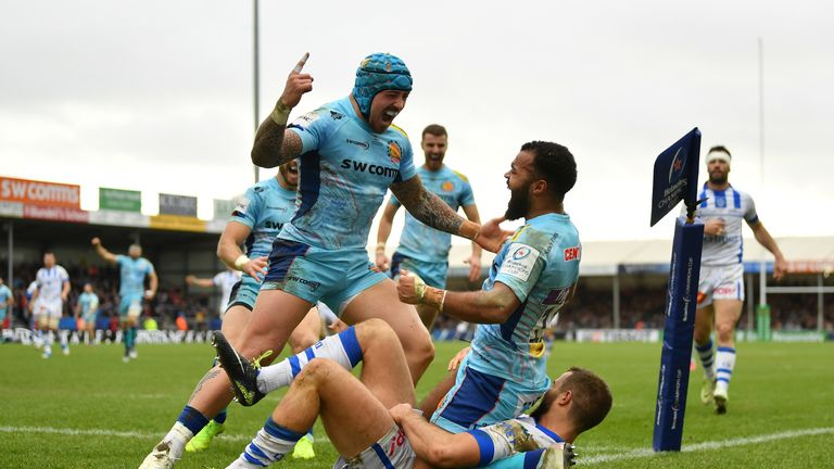 Jack Nowell celebrates with Tom O'Flaherty after the winger scored Exeter's bonus-point try against Castres at Sandy Park