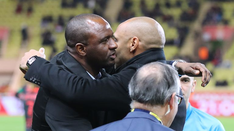 Patrick Vieira and Thierry Henry share a warm embrace prior to kick-off