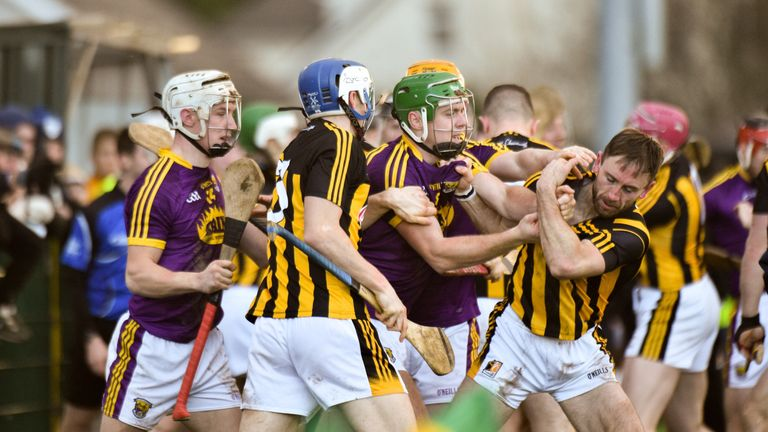 No love lost: Wexford and Kilkenny players tussle during the Walsh Cup semi-final