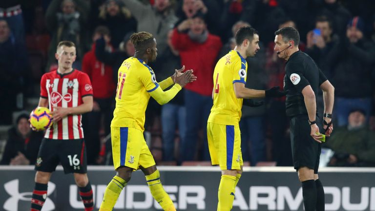 Zaha applauded referee Marriner after his first booking - leading to the second caution