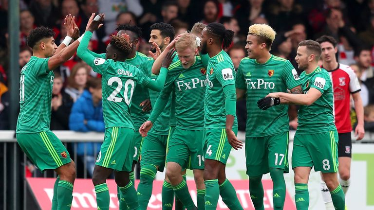Will Hughes celebrates with his team-mates after he scored Watford's first goal