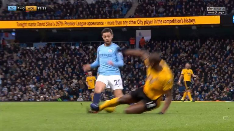 Willy Boly was sent off for this tackle on Bernardo Silva in the first half