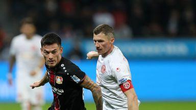 Bayer Leverkusen's Charles Aranguiz gets away from Oliver Fink