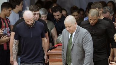 Nantes' defender Nicolas Pallois (L) and relatives of late Argentine footballer Emiliano Sala carry his coffin in his hometown of Progreso