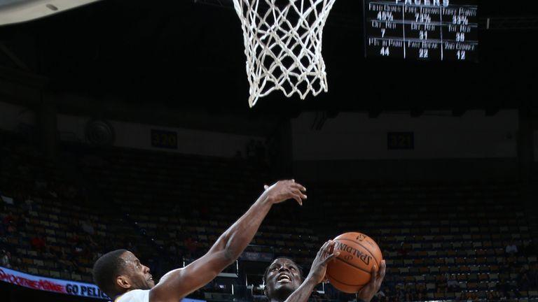 Darren Collison attacks the basket against New Orleans