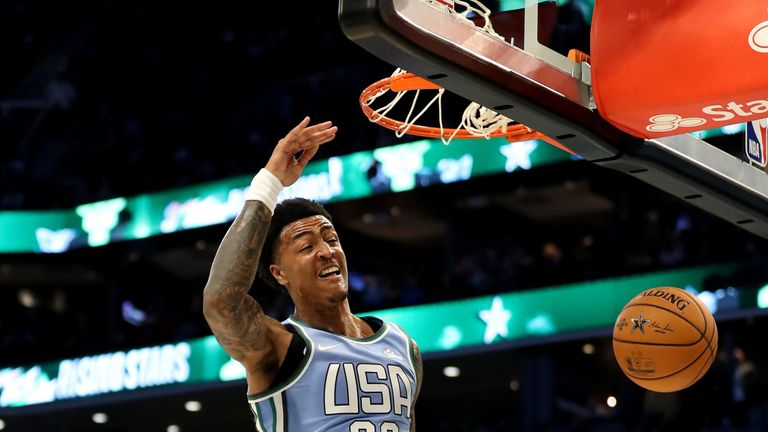 John Collins slams home a huge dunk