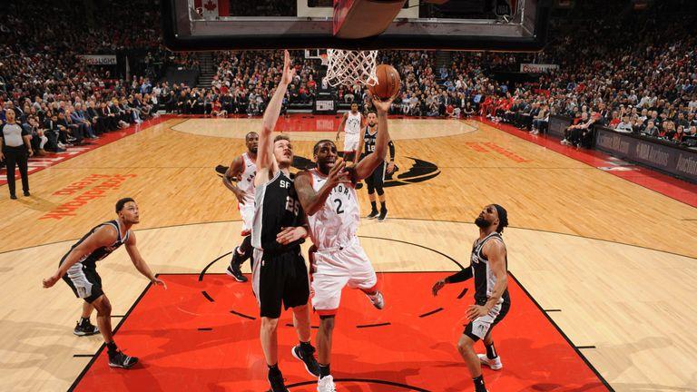 Kawhi Leonard scores at the rim against the San Antonio Spurs