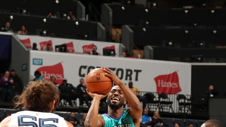 Kemba Walker fires a shot over Joakim Noah