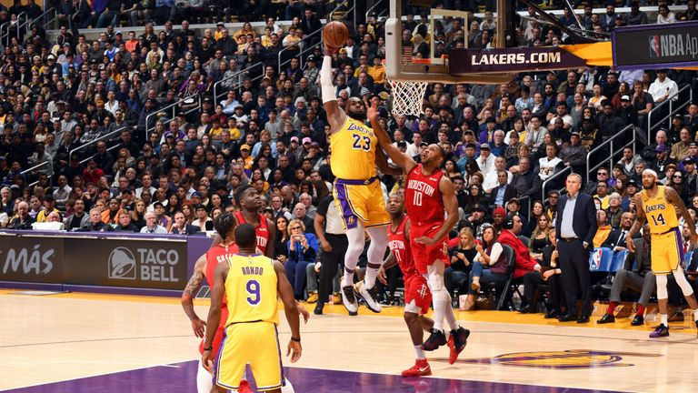 LeBron James soars for a huge State of Liberty dunk against the Houston Rockets