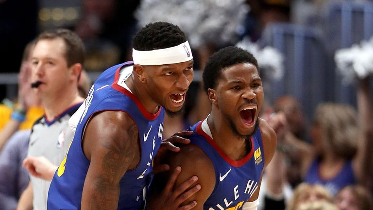 Mailk Beasley celebrates with team-mate Torrey Craig