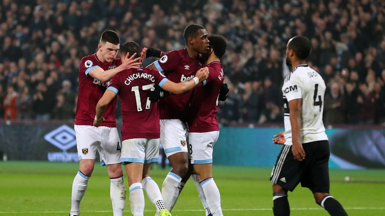 Javier Hernandez of West Ham United (2L) celebrates with his team-mates after scoring his side's first goal during the Premier League match between West Ham United and Fulham FC at the London Stadium on February 22, 2019 in London, United Kingdom